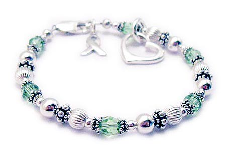 CBBRibbon 49   This bracelet comes with a sterling ribbon charm and lobster clasp. It is shown with light green crystals for lymphoma and they added an Open Heart Charm.