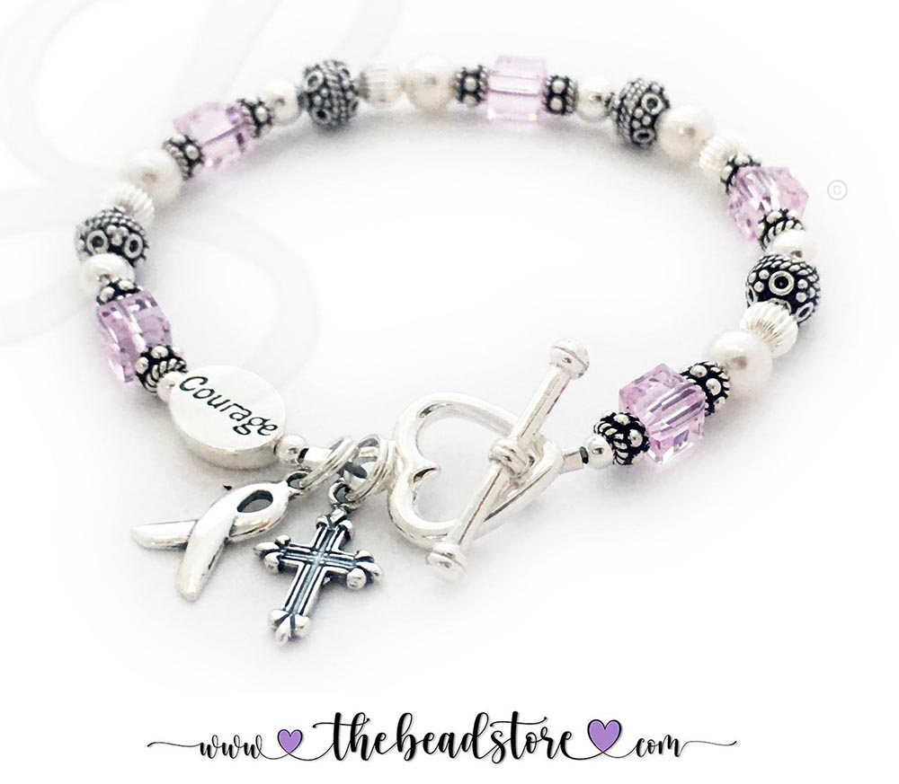 CBB-Ribbon25 - Breast Cancer Courage Bracelet Pink Breast Cancer Ribbon Bracelet includes Ribbon Charm. They picked a COURAGE bead and added a Fancy Cross Charm. A free sterling silver lobster or toggle are includedin the price. They upgraded to think Heart Toggle Clasp. *The crystals are pink... I know they look a little 'purpley' but it is the lighting.*