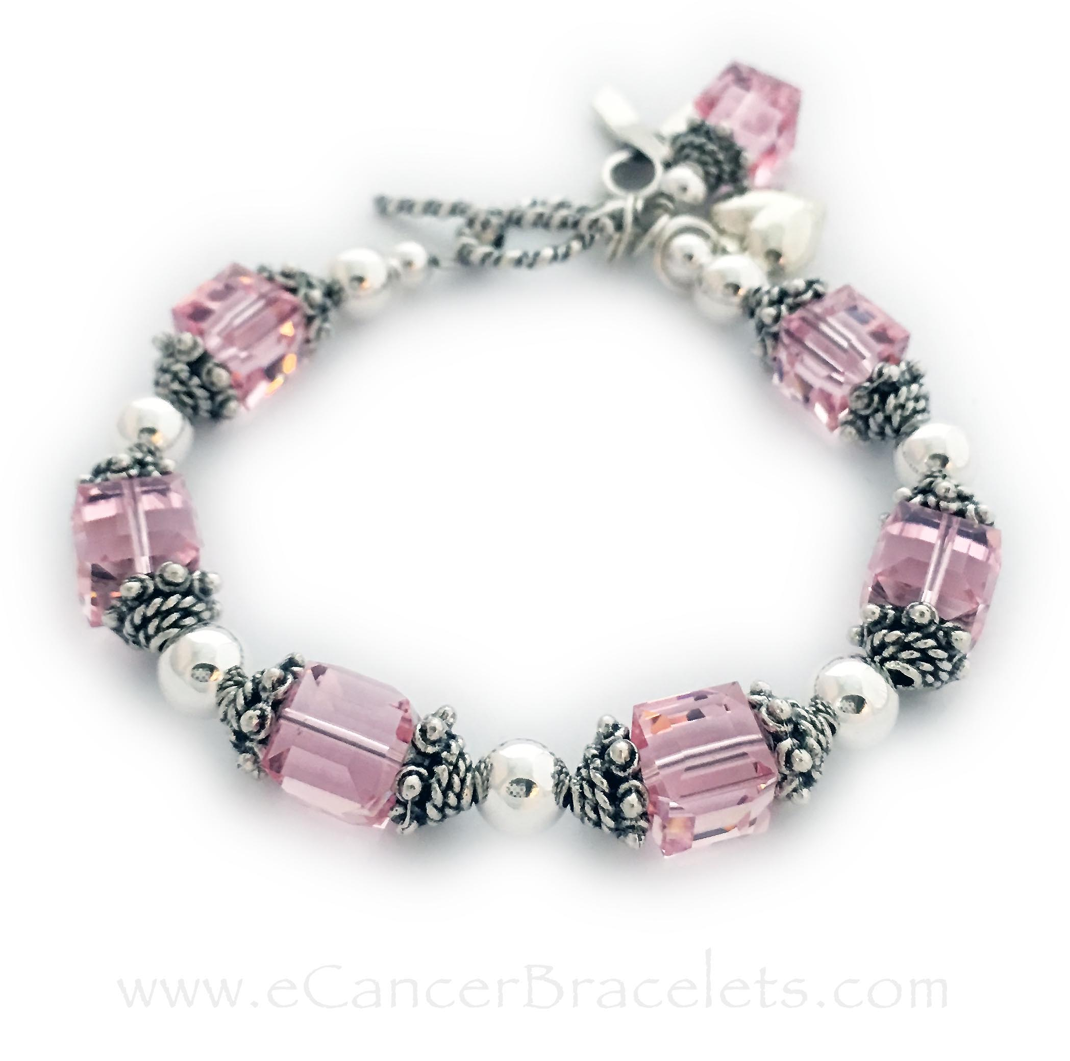 "This bracelet is shown with pink Swarovski Crystals for Breast Cancer Awareness. The corrdinating pink crystal dangle charm and ribbon charm are included in the price. This bracelet is 6 1/2"" and they added a Puffed Heart Charm."
