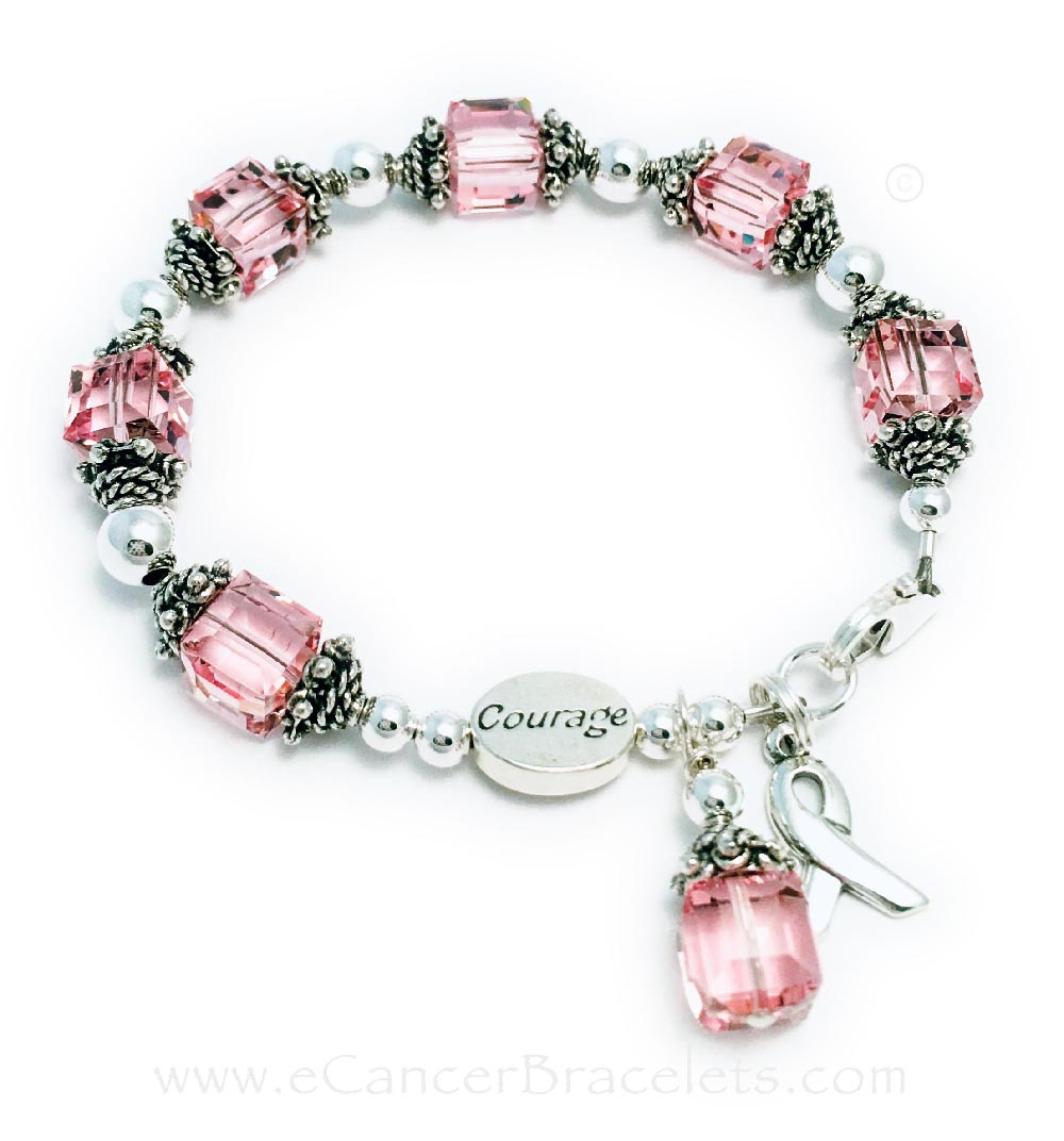 Large Breast Cancer Courage Pink Ribbon Bracelet Ribbon-34 This Sterling Silver Pink Ribbon Charm Bracelet is shown with a Courage Bead. The Crystal Dangle Charm and Ribbon Charm are included in the price.