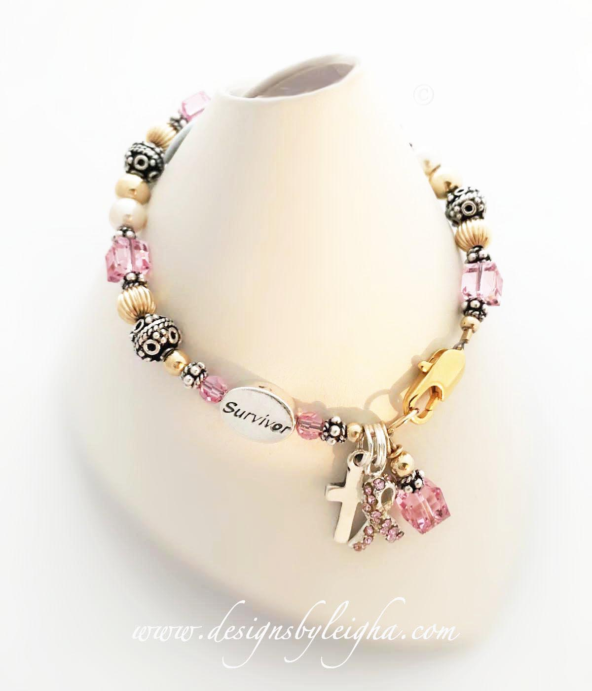 Breast Cancer Pink Ribbon Bracelet with a Pink Crystal Ribbon Charm, Crystal Dangle and an add-on Simple Cross Charm with a Survivor Bead.
