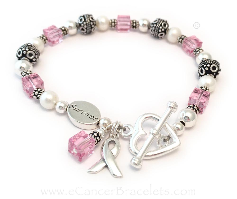 This Breast Cancer Survivor Pink Ribbon Bracelet is shown with 2 extras: a SURVIVOR bead and an upgraded Heart Toggle Clasp.