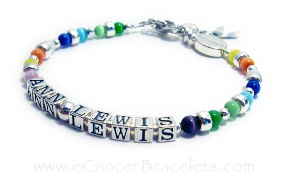 Cancer Bracelet with all Cancer Colors in Cats Eye Beads and a IN MEMORY bead with ANN LEWIS written on it and it includes the ribbon and heart charms. CBB-R43