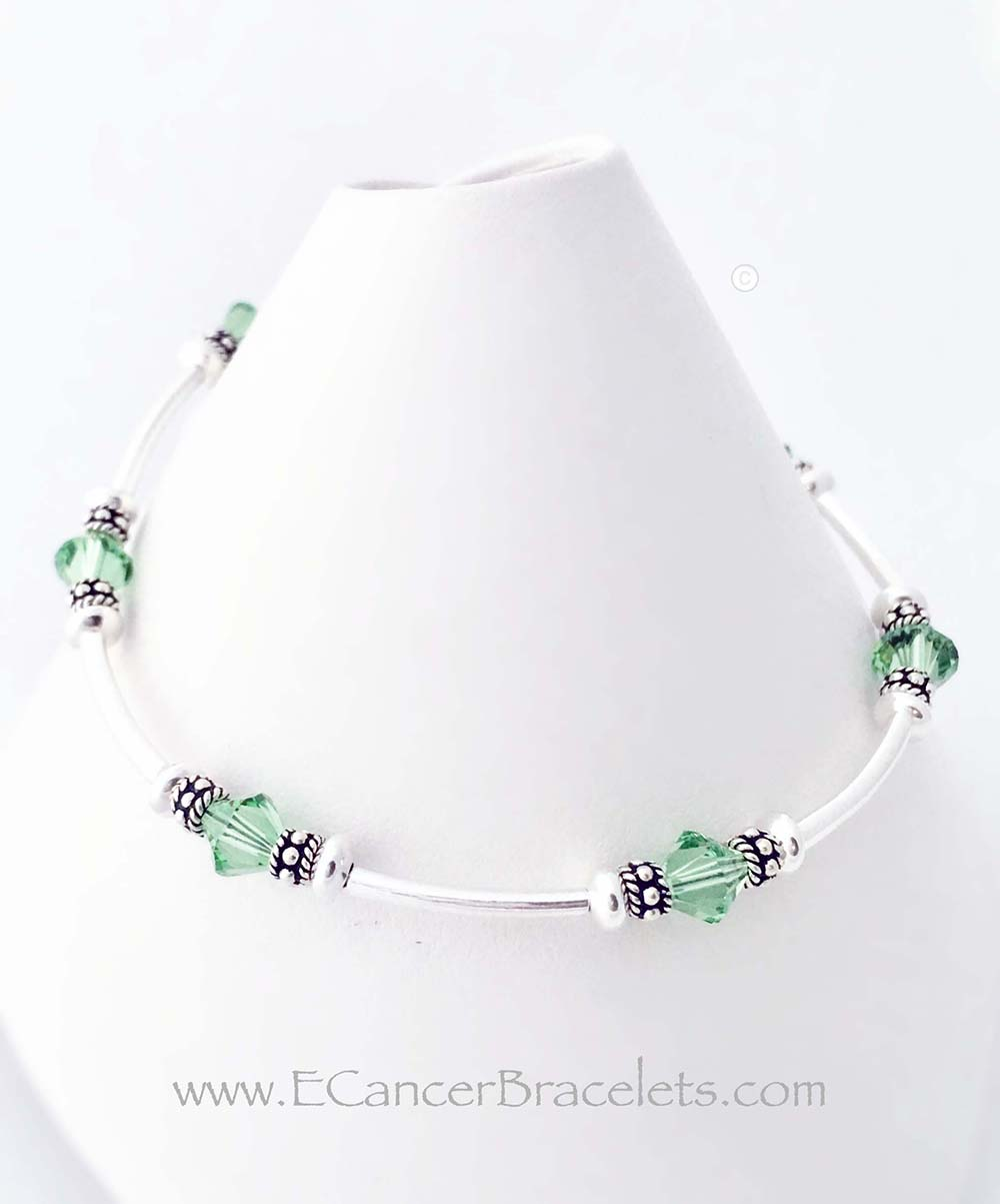 CBB- Ribbon37  Lymphoma Bracelet with Light Green Crystals and a Ribbon Charm.