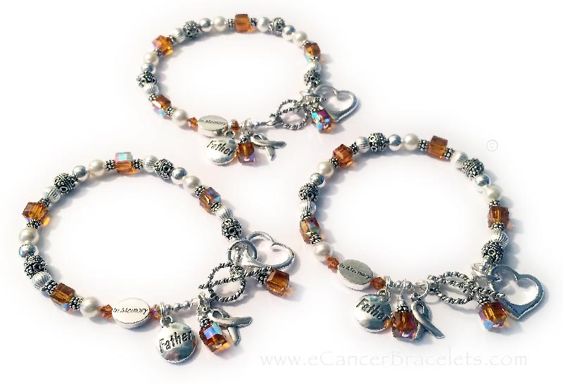CBB-Ribbon25 - Orange Ribbon Bracelets Shown with several add-ons...  My Orange Ribbon Bracelets come with a sterling silver Ribbon charm and colored dangle charm. They added: 1) IN MEMORY beads, 2) FATHER charms, 3) Open Heart Charms, 4) Additional November Crystal dangles.