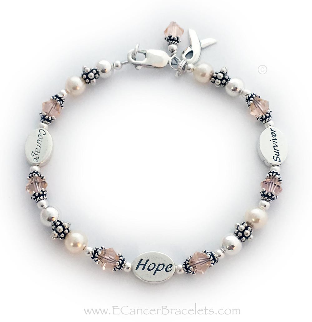 This Peach Ribbon Bracelet is shown with 3 message beads: Courageee, Hope and Survivor. The bracelet comes with a Ribbon Charm. They added a Peach Crystal Dangle Charm to their ordeer.