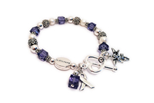Purple ribbon bracelet with an angel charm and heart toggle clasp