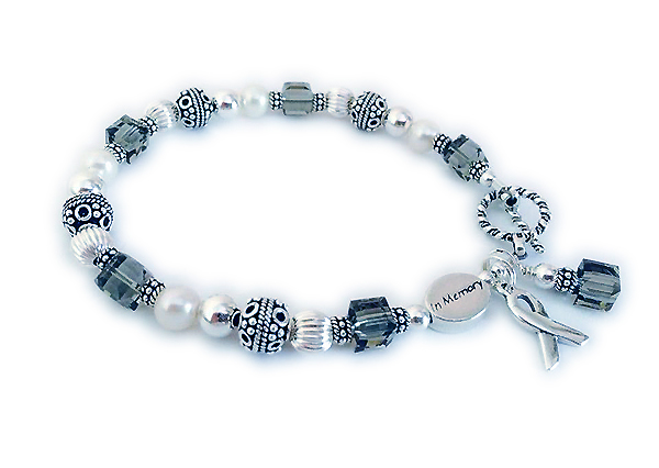 Grey symbolizes Brain Cancer awareness and psychiatric illnesses, diabetes and asthma. This Brain Cancer bracelet is shown with an IN MEMORY. The bracelet comes with a Grey Dangle and a Ribbon charm. You choose the clasp. One of my free Twisted Toggle Clasps is shown.
