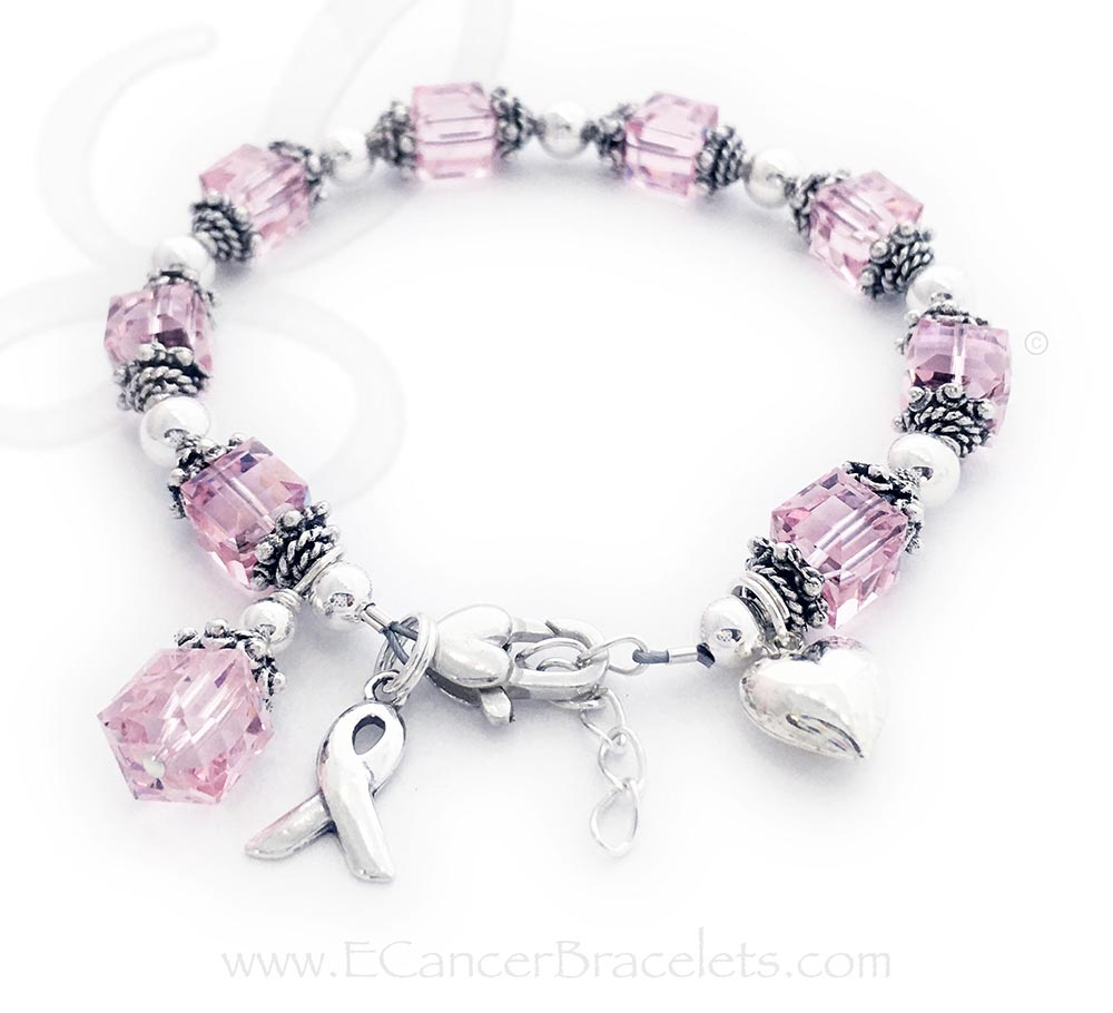 Large Breast Cancer Courage Pink Ribbon Bracelet Ribbon-34 This Sterling Silver Pink Ribbon Charm Bracelet is shown a Crystal Dangle Charm and Ribbon Charm and they are included in the price. They added a Puffed Heart Charm and a Heart Lobster Claw clasp to their order.