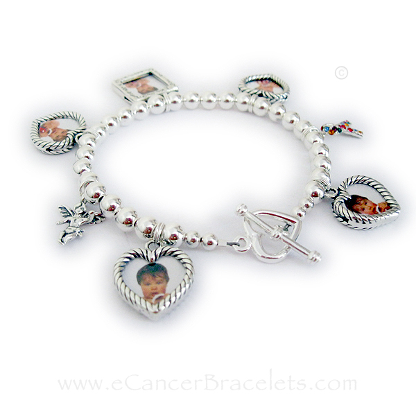 CBB-CB-2 This all .925 sterling silver Cancer Awareness Ribbon Charm Bracelet is shown with 5 Picture Frame Chsrms (4 heart frame charms and 1 square textured charm), an Autism Ribbon Charm and an Angel Charm.
