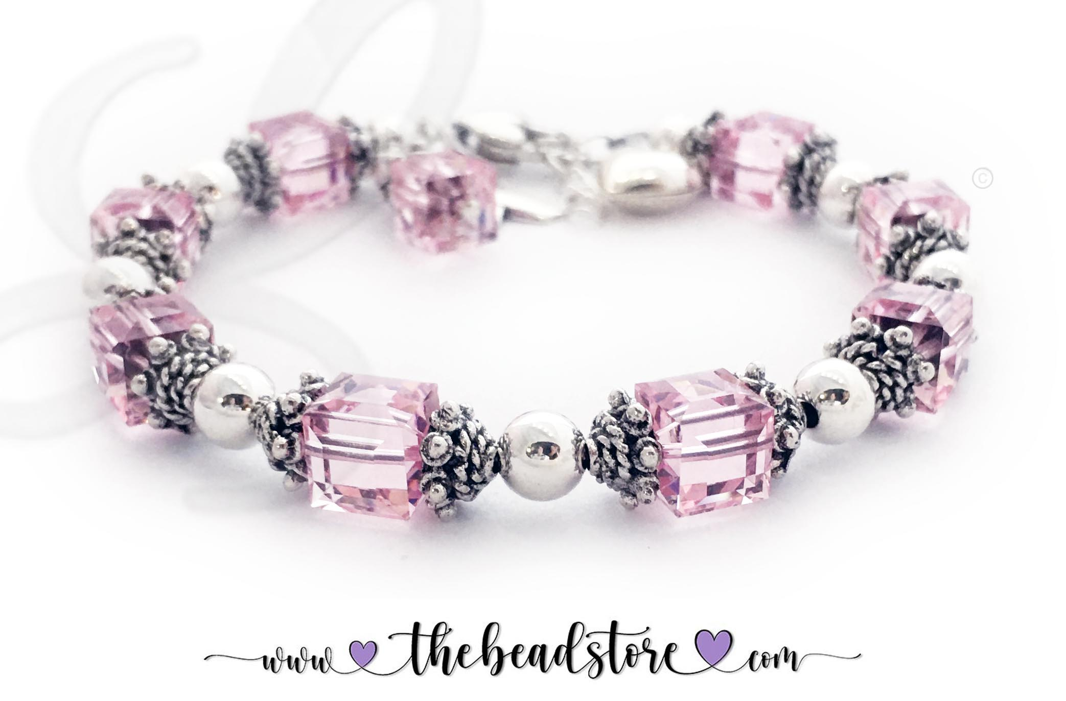 Bali Pink Ribbon Bracelet 34B Bracelet size 9 - Sterling Silver Ribbon Charm and Crystal Dangle are included in the price. The Sterling Silver Puffed Heart Charm is optional.