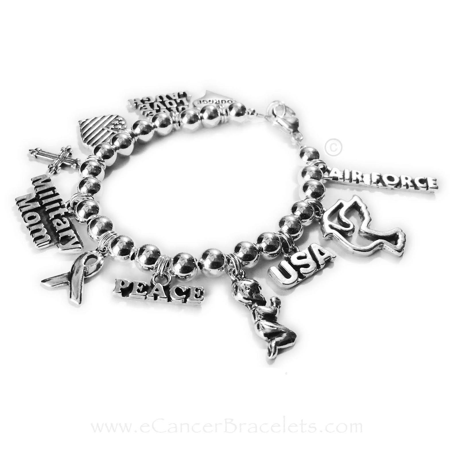 Cancer Awareness Ribbon Message Charm Bracelet - CBB-CB-2 Charms added: Courage in a Heart charm, Live Love Laugh charm, Heart Flag charm, Fancy Cross Chrarm, Military Mom Charm, Ribbon Charm, Peace Charm, Boy Praying Charm, USA Charm, Dove Charm, Air Force Charm.