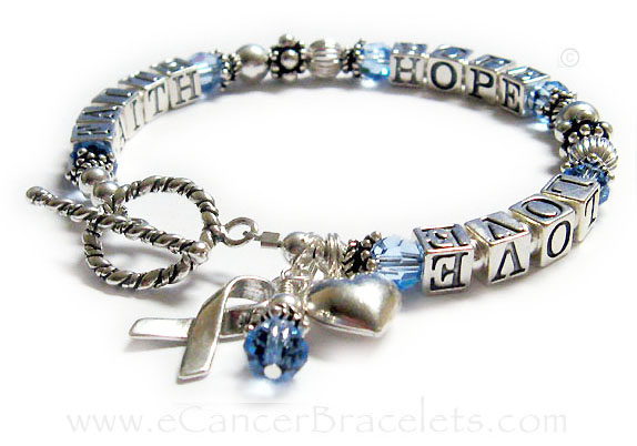 Prostate Cancer Awareness Bracelet (light blue) with a Ribbon Charm and Puffed Heart Charm.