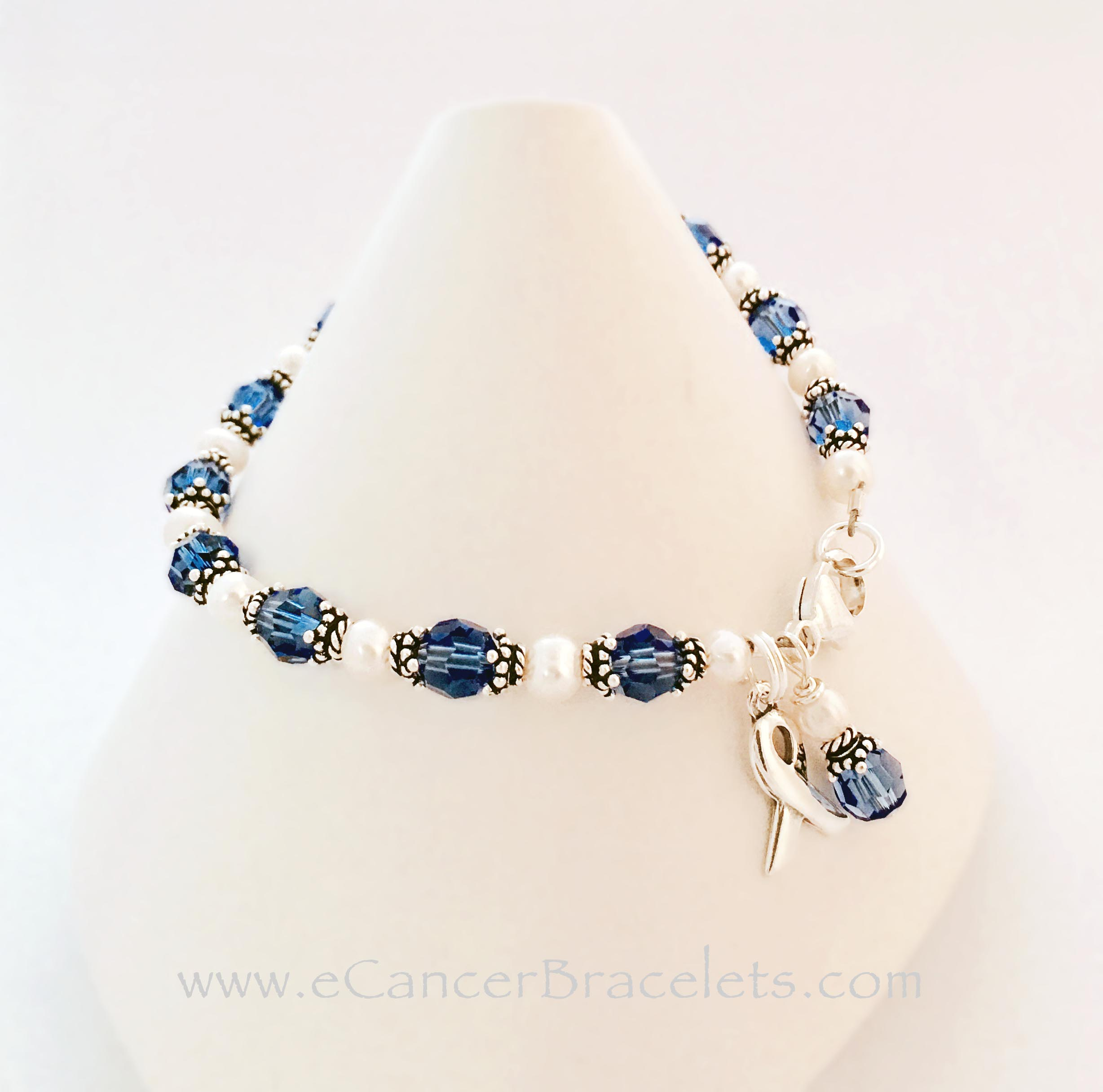 Colon Cancer Bracelet CBB-R31 This Blue Ribbon Bracelet is shown with dark blue crystals which can signify Colon Cancer. A Ribbon and Crystal dangle charm are included in the price.