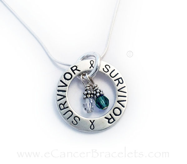 This Survivor Survivor Necklace is shown with 2 Cancer Awareness Charms Dark Green Ribbons symbolize depression and mental health awareness, the environment, kidney cancer, liver, tissue/organ donation, homeopathy Clear Ribbons symbolize lung cancer, violence against women, peace, right to life and retinal blastoma.