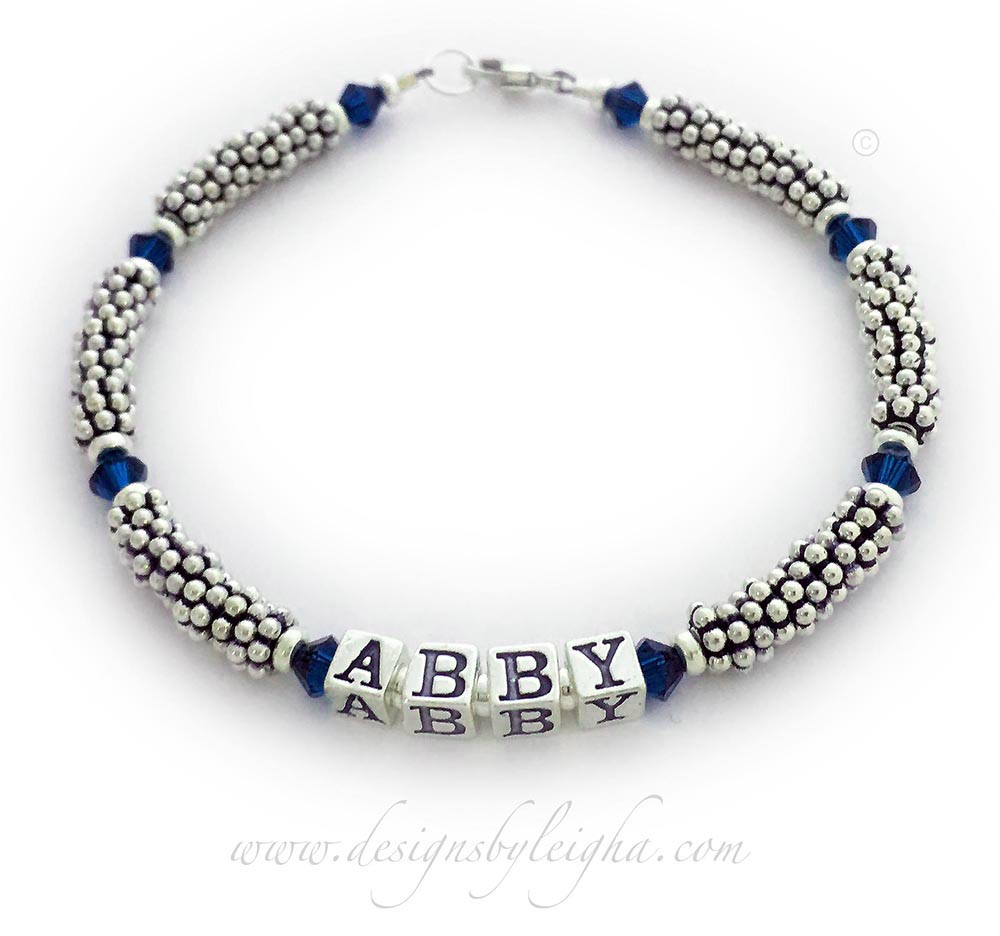 This is a 1-string Dark Blue Ribbon 5mm Rope Bracelet with a Ribbon Charm and a Lobster Claw Clasp. The Sterling Silver Rope Chain Beads and Dark Blue Swarovski Crystals are 4mm.
