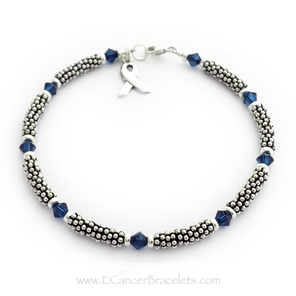 This is a 1-string Blue Ribbon 4mm Rope Bracelet with a Ribbon Charm and a Lobster Claw Clasp. The Sterling Silver Rope Chain Beads and the Blue Swarovski Crystals are 4mm.