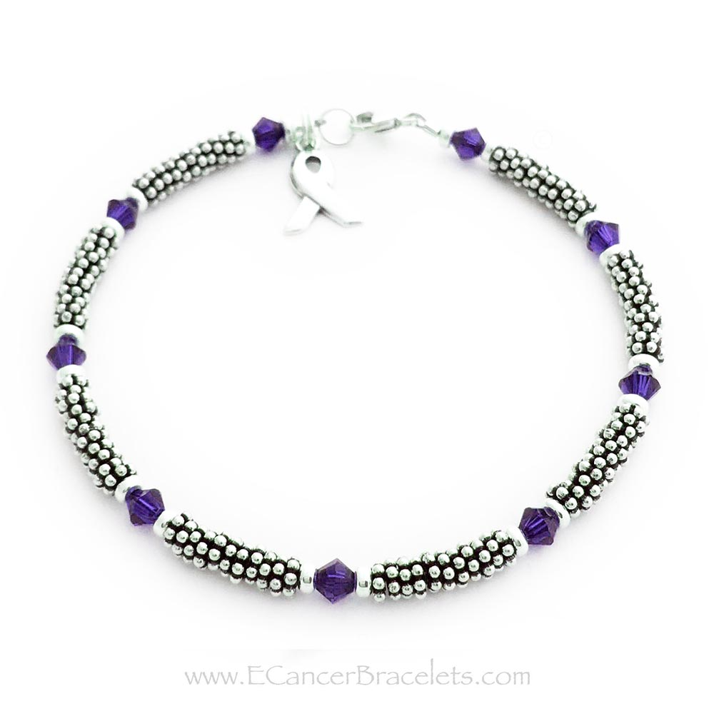 This is a 1-string Lavender or Purple Ribbon 4mm Rope Bracelet with a Ribbon Charm and a Lobster Claw Clasp. The Sterling Silver Rope Chain Beads and the Purple or Lavender Swarovski Crystals are 4mm.  The Lavender Ribbon can symbolizee Hodgkin's lymphoma awareness, Testicular Cancer and general cancer awareness.