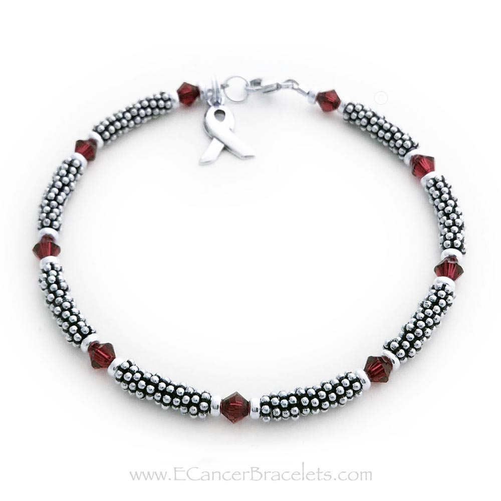 This is a 1-string Red Ribbon 4mm Rope Bracelet with a Ribbon Charm and a Lobster Claw Clasp. The Sterling Silver Rope Chain Beads and the Red Swarovski Crystals are 4mm.