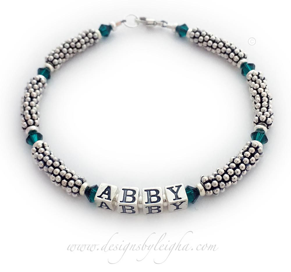 This is a 1-string Teal Ribbon 5mm Rope Bracelet with a Ribbon Charm and a Lobster Claw Clasp. The Sterling Silver Rope Chain Beads and Teal Swarovski Crystals are 4mm.