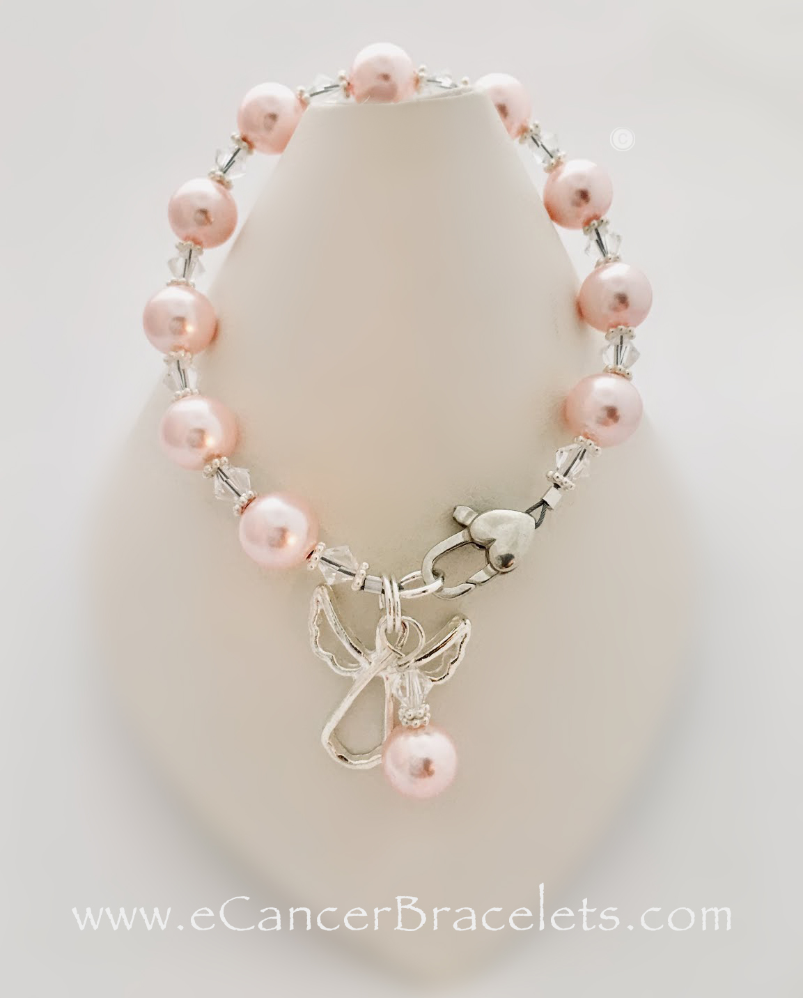 Guardian Angel Bracelet shown with Pink Swarovski Pearls. The charms shown come with the bracelet.