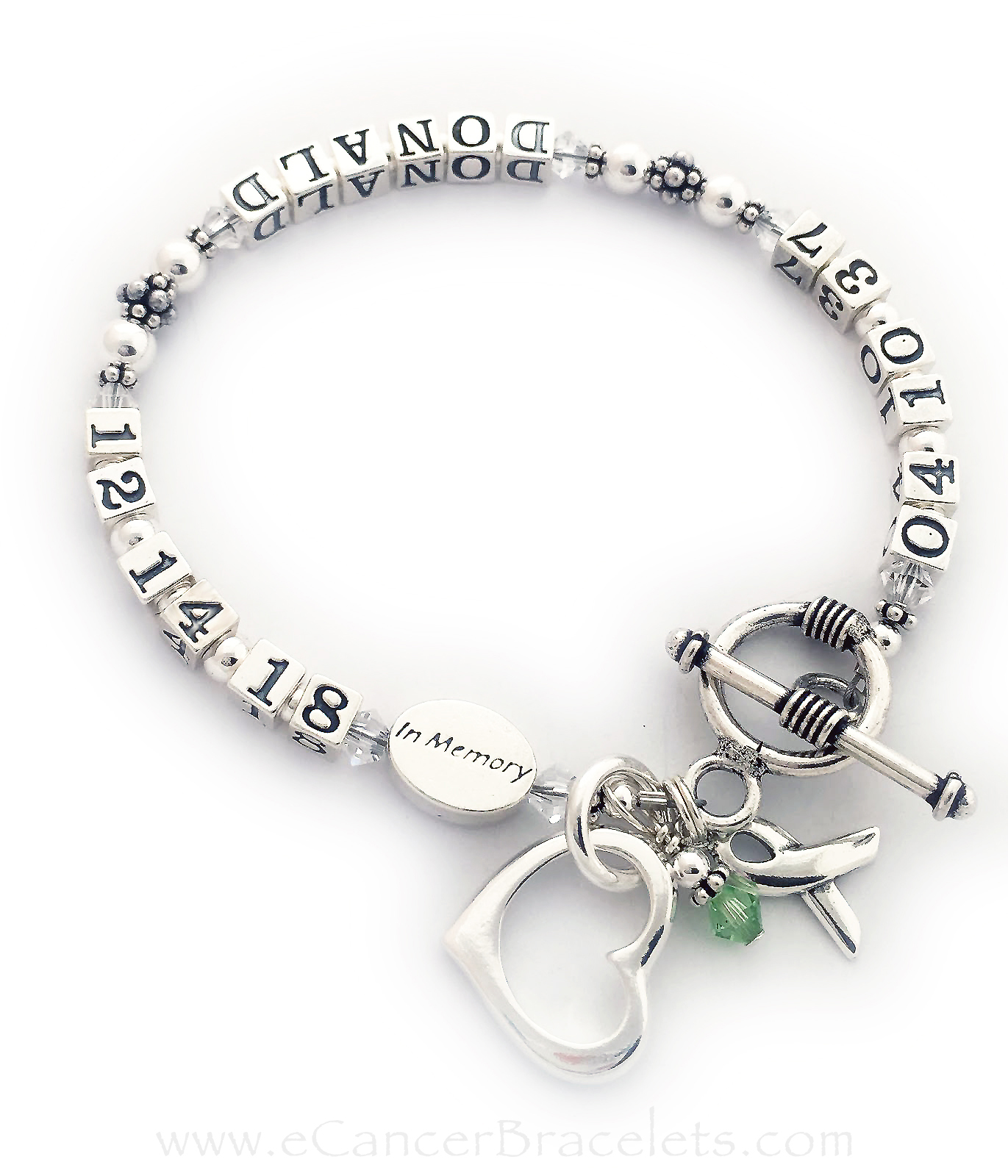 "CBB-LIFETIME/sterling This life time bracelet is shown with DONALD and clear crystals on the bracelet and a Peridot or Green Birthstone Crystal Dangle. They picked the ""smooth toggle clasp"" and added an Open Heart Charm."