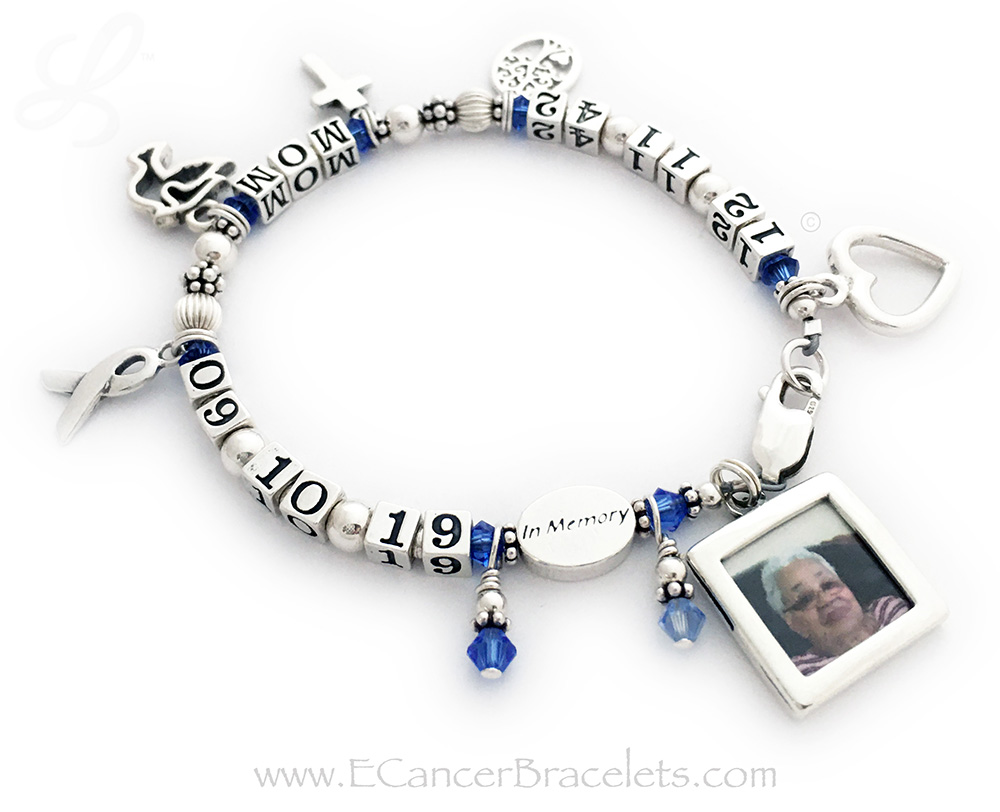 CBB-LIFETIME/sterling Colon Cancer In Memory Bracelet  This Life time / In Memory bracelet is shown with Mom and September (Colon Cancer) crystals. It comes with 2 charms: Ribbon Charm and Colon Cancer Charm. Theey added 6 add-ons; Heart Charm, Tree of Life Charm, Simple Cross Charm, Dove Charm and Picture Frame Charm.
