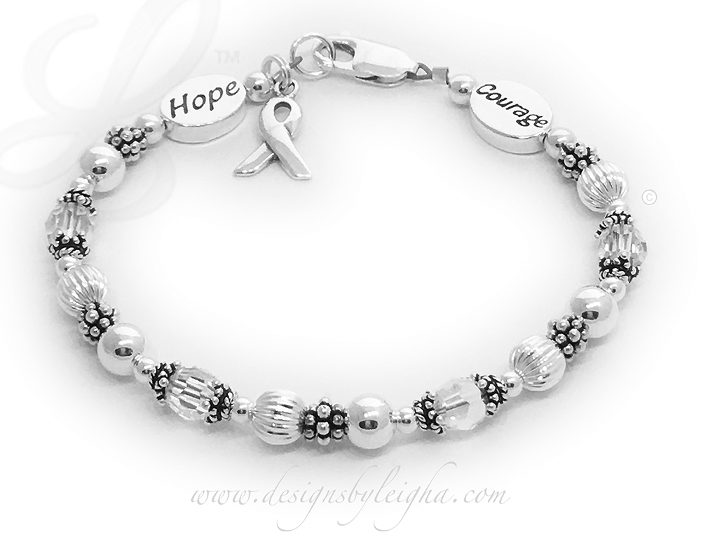 This is a Courage and Hope Lung Cancer Bracelet.  They picked CLEAR (for Lung Cancer) crystals and picked the simple, beautiful and free lobster claw clasp. The sterling silver ribbon charm and 1 Message Bead are included in the price.