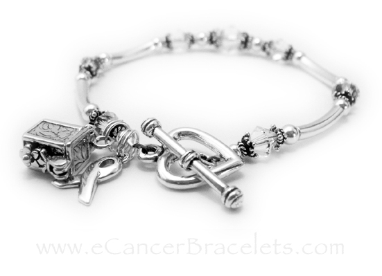 CBB-R35This Lung Cancer Awareness Bracelet doesn't come with any charms. They upgraded the clasp from one of my free lobster or toggles to a Heart Toggle Clasp and they added 2 charms: A Prayer Box Charm and a Ribbon Charm.
