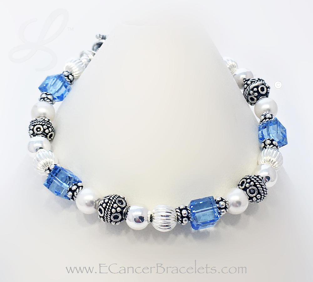 CBB-R25B Light Blue Ribbon Bracelet  Color(s) on Bracelet:: Light Blue/ Dec Clasp: Twisted Toggle Clasp Add ons: Puffed Heart Charm