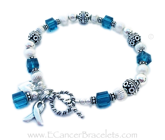 Uterian Cancer Bracelet with a heart charm and ribbon bracelet.